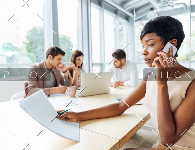 demo-attachment-2303-serious-businesswoman-with-documents-talking-on-P9Q6LX6@2x